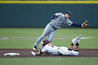 Georgia Tech Yellow Jackets shortstop Luke Waddell (7) leaps for a wie throw as Nick Biddison (24) of the Virginia Tech Hokies slides head-first into second base at English Field on April 17, 2021 in Blacksburg, Virginia. (Brian Westerholt/Four Seam Images)