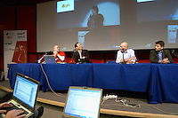 Neville Hobson, Gabe McIntyre, Jian Ni, Olivier Dufour and Roy Lindemann, with conference delegates hacking away at their computers, commenting the debate live, their laptop screens seen in the foreground, at the Les Blog conference in Paris December 2005 on blogging, new media and internet strategy