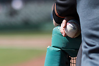 A San Jose Giants player holds a baseball during a California League game against the Stockton Ports on April 9, 2019 in Stockton, California. San Jose defeated Stockton 4-3. (Zachary Lucy/Four Seam Images)