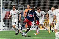 FOXBOROUGH, MA - JULY 23: Edward Kizza #19 of New England Revolution II attempts to control the ball during a game between Toronto FC II and New England Revolution II at Gillette Stadium on July 23, 2021 in Foxborough, Massachusetts.