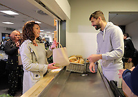 Pictured: Fernando Llorente and Angel Rangel handing out goodie bags Tuesday 29 November 2016<br /> Re: Soup kitchen for homeless people organised by Swansea City FC and Woolwich at the Liberty Stadium, Wales, UK