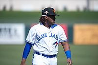 Surprise Saguaros third baseman Vladimir Guerrero Jr. (27), of the Toronto Blue Jays organization, warms up before an Arizona Fall League game against the Salt River Rafters on October 9, 2018 at Surprise Stadium in Surprise, Arizona. The Rafters defeated the Saguaros 10-8. (Zachary Lucy/Four Seam Images)