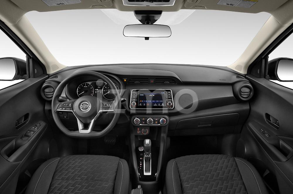 Stock photo of straight dashboard view of 2021 Nissan Kicks - 5 Door SUV Dashboard