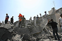 """Palestinians inspect the destroyed building belonging to the Hamas Executive Force after an Israeli air strike in Gaza May 17, 2007. The Israeli military said it carried out an air strike in Gaza City on Thursday and local residents said the target was a building housing Hamas' Executive Force.""""PHOTO BY Fady Adwan"""""""""""