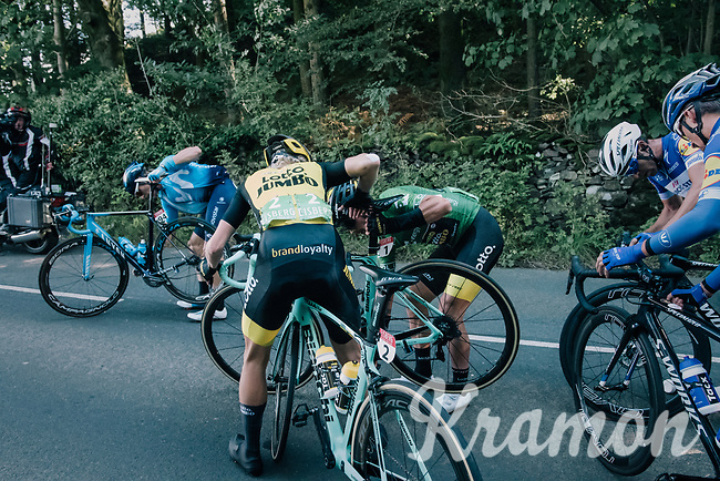 GC leader Primoz Roglic (SVK/LottoNL-Jumbo) getting his chain back on and getting helped on his way again after a minor crash early on in the race<br /> <br /> Racing in/around Lake District National Parc / Cumbria<br /> <br /> Stage 6: Barrow-in-Furness to Whinlatter Pass   (168km)<br /> 15th Ovo Energy Tour of Britain 2018