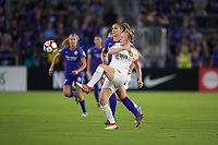 Orlando, FL - Saturday March 24, 2018: Utah Royals defender Becky Sauerbrunn (4) clears the ball as Orlando Pride forward Alex Morgan (13) pressures during a regular season National Women's Soccer League (NWSL) match between the Orlando Pride and the Utah Royals FC at Orlando City Stadium. The game ended in a 1-1 draw.
