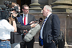 Rod Petrie leaves the SFA's AGM at Glasgow City Chambers