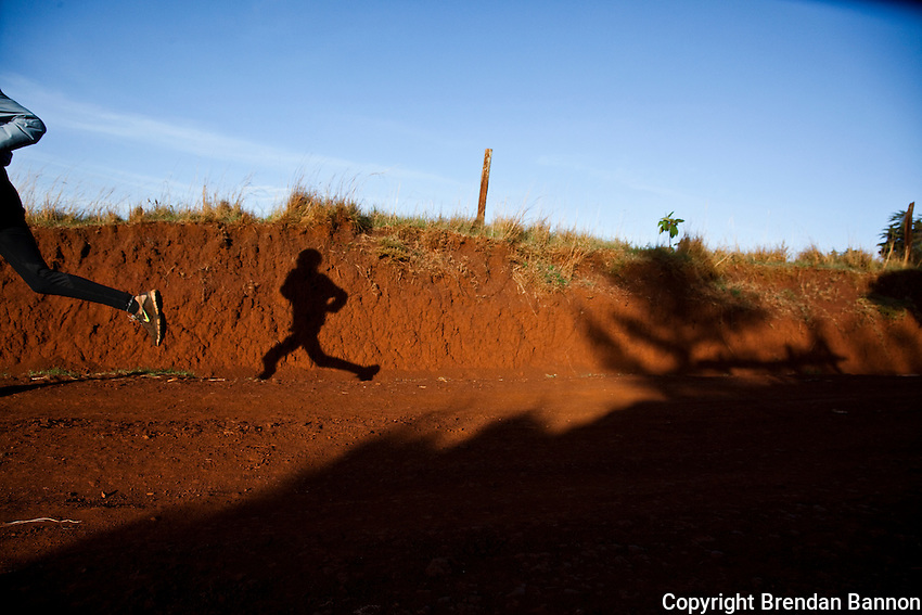 The shadow of  Kenyan runner Johanna Kariankei, 17. Kenyan athletes are hit by the economic crisis which has robbed races and runners of crucial sponsorship. Johanna, who has never run outside Kenya, hopes the crisis will pass and he will be able to fulfil his dream of winning good money from international races.