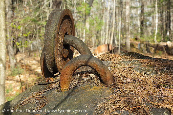 An old pulley in a boulder at the abandoned Redstone Granite quarry in Conway, New Hampshire. This abandoned quarry opened in the late eighteen hundreds and closed in the nineteen forties. The granite harvested from this quarry can still be found in buildings and monuments throughout New England.