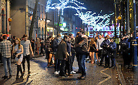 Pictured: A crowd of people in the early hours of New Year's Day. Sunday 01 January 2017<br />
