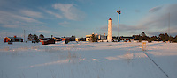 Marjaniemi Lighthouse on Hailuoto Island at sundown in early April   in the Gulf of Bothnia, Finland.