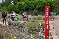 Chidren with docent in Crescent Farm, sustainable demonstation garden; Los Angeles County Arboretum and Botanic Garden