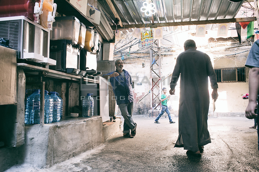 Scene from the streets of Shatila. In the camp they are lots of vendors for fruit juice, small shops for essentials and water. Everyone is making a living for the camp, to run the micro economy for the camp community. Beirut. Lebanon. August 2015