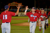 Fort Myers Miracle Michael Helman (8) high fives Luis Ramirez (19) after a Florida State League game against the Bradenton Marauders on April 23, 2019 at LECOM Park in Bradenton, Florida.  Fort Myers defeated Bradenton 2-1.  (Mike Janes/Four Seam Images)