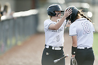 Bentonville catcher Sara Watson (9) and center fielder Kadence Stafford (10) react, Thursday, April 29, 2021 during a softball game at Bentonville High School in Bentonville. Check out nwaonline.com/210430Daily/ for today's photo gallery. <br /> (NWA Democrat-Gazette/Charlie Kaijo)