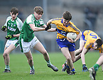Padraic O Donoghue of  Clare  in action against Craig Carew of  Limerick during their Munster Minor football quarter final at  Cusack Park. Photograph by John Kelly.