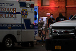 Medical workers attend to a patient arriving by ambulance at Maimonides Medical Center on March 28, 2020 in Brooklyn, NY.  NYC's daily death toll from the coronavirus nearly tripled from the previous 24-hour period from 85 on Friday to 222 on Saturday.  Photograph by Michael Nagle/Redux