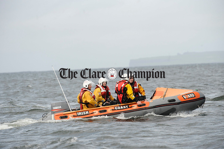 The Doolin Irish Coast Guard on standby at the Leon Currach Regatta at Seafield, Quilty. Photograph by John Kelly.
