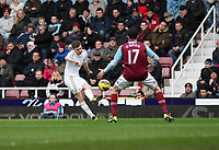 Barclays Premier League, West Ham United (red)V Swansea City Fc (white), Boelyn Ground, 02/02/13<br /> Pictured: Swans defender Ben Davies whips in a cross past O'brien<br /> Picture by: Ben Wyeth / Athena Picture Agency<br /> info@athena-pictures.com