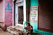 A man is seen brushing his teeth outside a yoga school in the narrow alleys of the ancient city of Varanasi in Uttar Pradesh, India. Photograph: Sanjit Das/Panos