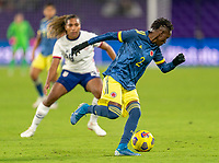 ORLANDO, FL - JANUARY 18: Kelly Ibarguen #2 of Colombia is defended by Catarina Macario #29 of the USWNT during a game between Colombia and USWNT at Exploria Stadium on January 18, 2021 in Orlando, Florida.