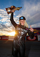 Nov 1, 2020; Las Vegas, Nevada, USA; NHRA pro stock motorcycle rider Angie Smith celebrates with the Wally trophy after winning the NHRA Finals at The Strip at Las Vegas Motor Speedway. Mandatory Credit: Mark J. Rebilas-USA TODAY Sports