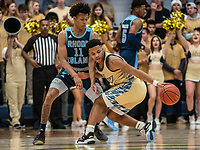WASHINGTON, DC - FEBRUARY 8: Jeff Dowtin #11 of Rhode Island watches as Jameer Nelson Jr. #12 of George Washington reaches back for the ball during a game between Rhode Island and George Washington at Charles E Smith Center on February 8, 2020 in Washington, DC.