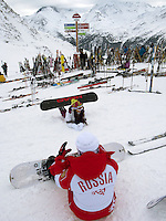 """Switzerland. Canton Valais. Russian snowboarders in Verbier at  """" La Chaux"""" ( 2260 meters ). Verbier is a village located in the municipality of Bagnes in the Val de Bagnes. Verbier is one of the largest holiday resort and ski areas in the Swiss Alps. Russian tourists. Indication signs. 3.01.2012 © 2012 Didier Ruef"""