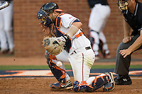 Catcher Franco Valdes #33 of the Virginia Cavaliers blocks a pitch in the dirt against the St. John's Red Storm in the championship game of the Charlottesville Regional at Davenport Field on June 7, 2010, in Charlottesville, Virginia.  The Cavaliers defeated the Red Storm 5-3.  Photo by Brian Westerholt / Four Seam Images