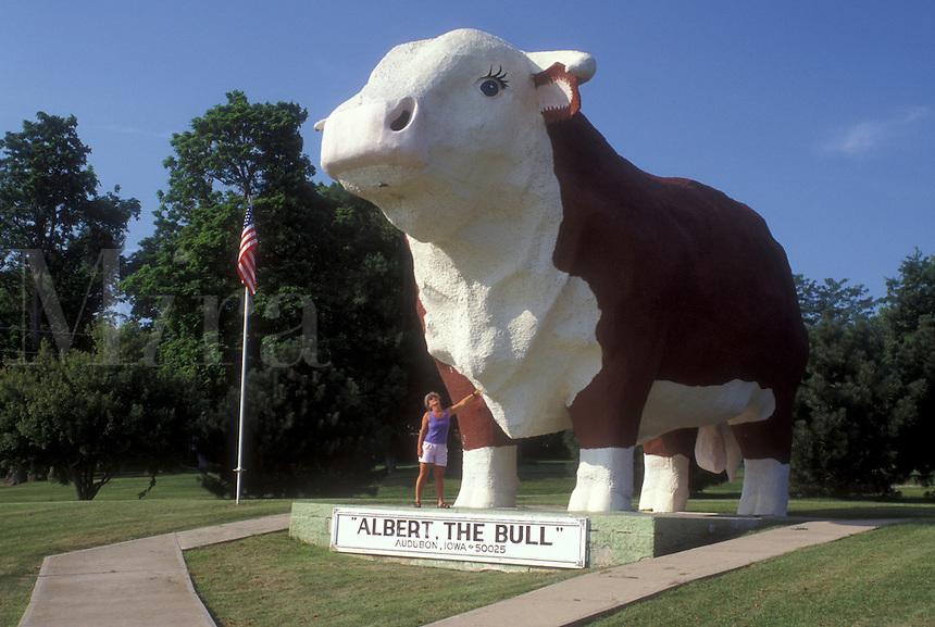 "AJ0278, Iowa, Audubon, World's Largest Bull """"Albert"""" (30 feet tall) statue towers over woman at park in Audubon."