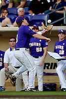 LSU Tigers first baseman Mason Katz #8 runs to make a catch in foul territory against the Mississippi State Bulldogs during the NCAA baseball game on March 17, 2012 at Alex Box Stadium in Baton Rouge, Louisiana. The 10th-ranked LSU Tigers beat #21 Mississippi State, 4-3. (Andrew Woolley / Four Seam Images).