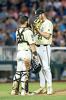 Vanderbilt Commodores pitcher Tyler Brown (21) talks with catcher Ty Duvall (20) on the mound during Game 12 of the NCAA College World Series against the Louisville Cardinals on June 21, 2019 at TD Ameritrade Park in Omaha, Nebraska. Vanderbilt defeated Louisville 3-2. (Andrew Woolley/Four Seam Images)