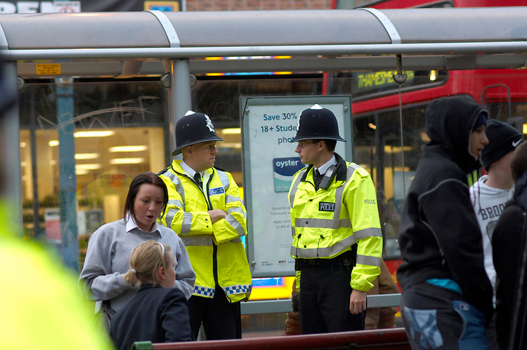 Community Police officers - On the bus route where many school meet in the Broadway area of Bexley Heath town centre Kent.
