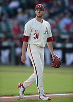 Arkansas starter Caleb Bolden walks off the field Wednesday, April 7, 2021, after the third out of the top of the second inning of the Razorbacks' 10-3 win over UALR at Baum-Walker Stadium in Fayetteville. Visit nwaonline.com/210408Daily/ for today's photo gallery. <br /> (NWA Democrat-Gazette/Andy Shupe)