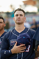 Jacksonville Jumbo Shrimp John Silviano (8) stands for the national anthem before a game against the Pensacola Blue Wahoos on August 15, 2018 at Blue Wahoos Stadium in Pensacola, Florida.  Jacksonville defeated Pensacola 9-2.  (Mike Janes/Four Seam Images)