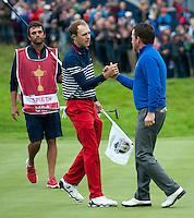 28.09.2014. Gleneagles, Auchterarder, Perthshire, Scotland. The Ryder Cup, final day.  Jordan Spieth [USA] congratulates Graeme McDowell (EUR) on the 17th. Graeme McDowell (EUR) won Team Europe's second point on Sunday Singles.  Team Europe won the trophy sixteen and a half points to eleven and a half.