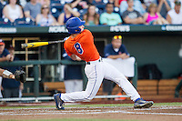 Florida Gators outfielder Harrison Bader (8) follows through on his swing against the Virginia Cavaliers in Game 13 of the NCAA College World Series on June 20, 2015 at TD Ameritrade Park in Omaha, Nebraska. The Cavaliers beat the Gators 5-4. (Andrew Woolley/Four Seam Images)