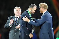 Prince Harry presents a medal to, and commiserates with, Michael Cheika, Australia Head Coach during the Rugby World Cup Final between New Zealand and Australia - 31/10/2015 - Twickenham Stadium, London<br /> Mandatory Credit: Rob Munro/Stewart Communications