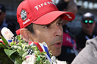 30th May 2021, Indianapolis, Indiana, USA; NTT Indy Car Series driver Helio Castroneves does an interview after winning the 105th running of the Indianapolis 500 on May 30, 2021 at the Indianapolis Motor Speedway in Indianapolis, Indiana.