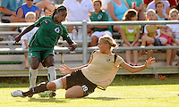 Carrie Drew #19 slides in on Eniola Aluko...Saint Louis Athletica tied FC Gold Pride 1-1, at Anheuser-Busch Soccer Park, Fenton, MO.