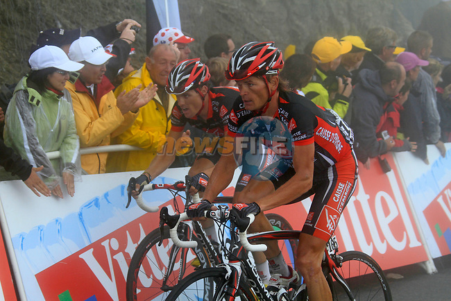 Vasili Kiryienka (BLR) and Luis León Sánchez Gil (ESP) Caisse d'Epargne approach the summit finish of the Col du Tourmalet during a wet foggy Stage 17 of the 2010 Tour de France running 174km from Pau to Col du Tourmalet, France. 22nd July 2010.<br /> (Photo by Eoin Clarke/NEWSFILE).<br /> All photos usage must carry mandatory copyright credit (© NEWSFILE | Eoin Clarke)