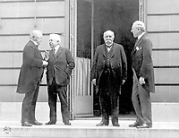 """The """"Big Four"""" at the Paris Peace Conference in 1919, following the end of World War I.<br /> <br /> Council of Four at the WWI Paris peace conference, May 27, 1919 (candid photo) (L - R) Prime Minister David Lloyd George (Great Britian) Premier Vittorio Orlando, Italy, French Premier Georges Clemenceau, President Woodrow Wilson"""