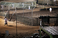Guantanamo detainees wake up before dawn to exersise before the morning prayer inside Camp Delta at the American naval base at Guantanamo Bay, where over 600 alleged al Qaeda members have been held indefinitely. Described by the US as 'unlawful enemy combatants', they were captured primarily in Afghanistan during the 'war against terror'. .
