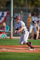 Minnesota Golden Gophers pinch hitter Riley Smith (18) hits a single during a game against the Boston College Eagles on February 23, 2018 at North Charlotte Regional Park in Port Charlotte, Florida.  Minnesota defeated Boston College 14-1.  (Mike Janes/Four Seam Images)