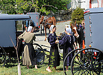 """Amish girls talk in between horse and buggies on farm in Pennsylvania Dutch Amish country in Lancaster County PA, Pennsylvania Dutch in Amish Country Lancaster County Pennsylvania, Amish, Horse and buggy with amish family on backroads of Pennsylvainia, buggy, amish family, buggy and horse, Commonwealth of Pennsylvania, Commonwealth of Pennsylvania, natives, Northeasterners, Middle Atlantic region, Philadelphia, Keystone State, 1802, Thirteen Colonies, Declaration of Independence, State of Independence, Liberty, Conestoga wagons, Quaker Province, Founding Fathers, 1774, Constitution written, Photography history, Fine art by Ron Bennett Photography.com, Stock Photography, Fine art Photography and Stock Photography by Ronald T. Bennett Photography ©, All rights reserved copyright Ron Bennett Photography.Com, FINE ART and STOCK PHOTOGRAPHY FOR SALE, CLICK ON  """"ADD TO CART"""" FOR PRICING,"""