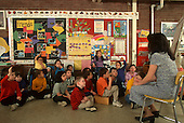 MR / Schenectady, New York. Zoller Public Elementary School. Grade 1 inclusion classroom. Teacher with class group. About one quarter of class includes mainstreamed special education students with mixed disabilities including learning disability, ADHD, spina bifida, scoliosis, and cerebral palsy. MR: BO-MF. © Ellen B. Senisi