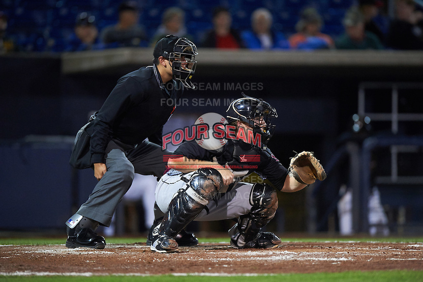 Home plate umpire Richard Genera and Wisconsin Timber Rattlers catcher Gregory McCall (21) during the second game of a doubleheader against the Quad Cities River Bandits on August 19, 2015 at Modern Woodmen Park in Davenport, Iowa.  Quad Cities defeated Wisconsin 8-1.  (Mike Janes/Four Seam Images)