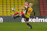 Daryl Horgan of Wycombe Wanderers and Will Hughes of Watford during the Sky Bet Championship behind closed doors match between Watford and Wycombe Wanderers at Vicarage Road, Watford, England on 3 March 2021. Photo by David Horn.