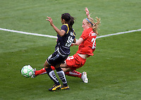 Washington Freedom's Becky Sauerbrunn. tackles LA Sol's Marta. The LA Sol defeated the Washington Freedom 2-0 in the opening game of Womens Professional Soccer at Home Depot Center stadium on Sunday March 29, 2009.  .Photo by Michael Janosz