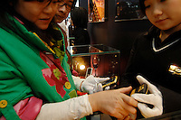 """Mobile telephones by xxx, called the ultimate jewellery phone, valued at 100,000 rnb (£7,000 sterling) at the """"Top Show"""" luxury goods fair in Shenzhen, China."""